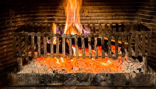 Log burning in a fireplace
