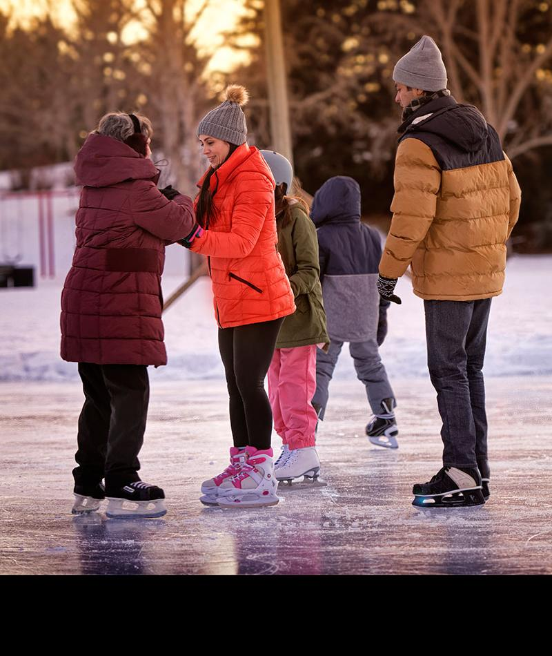 People skating on an outdoor ice rink