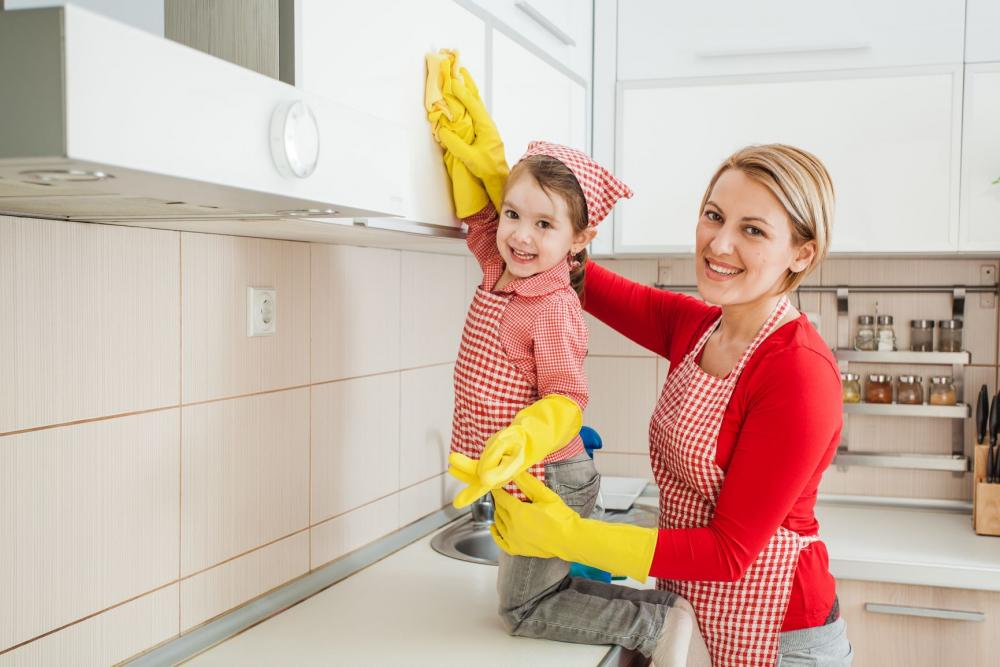 Mom and daughter cleaning