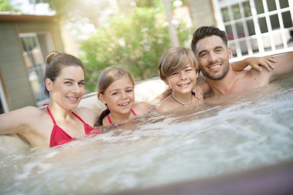 A family enjoying their hot tub.