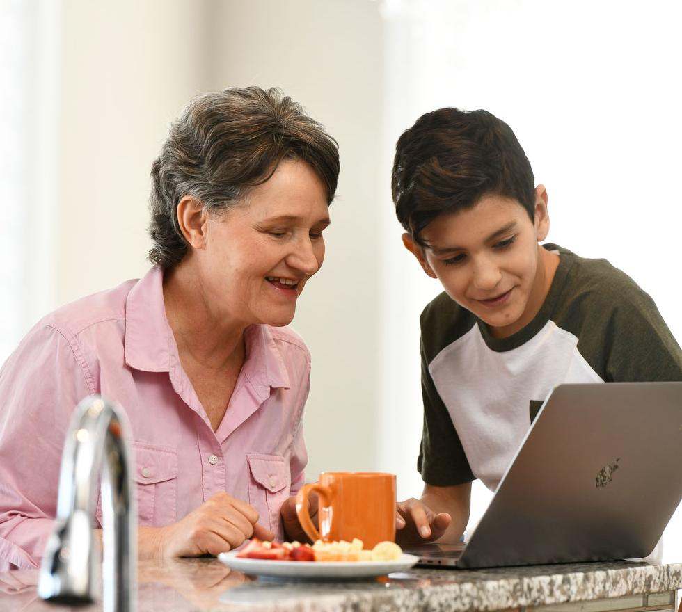 Grandma and grandson looking at a laptop