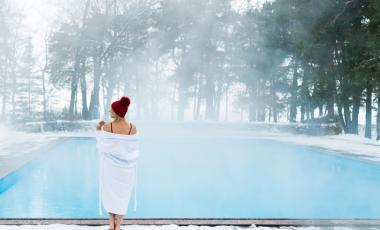 A woman stands by her winterized pool.