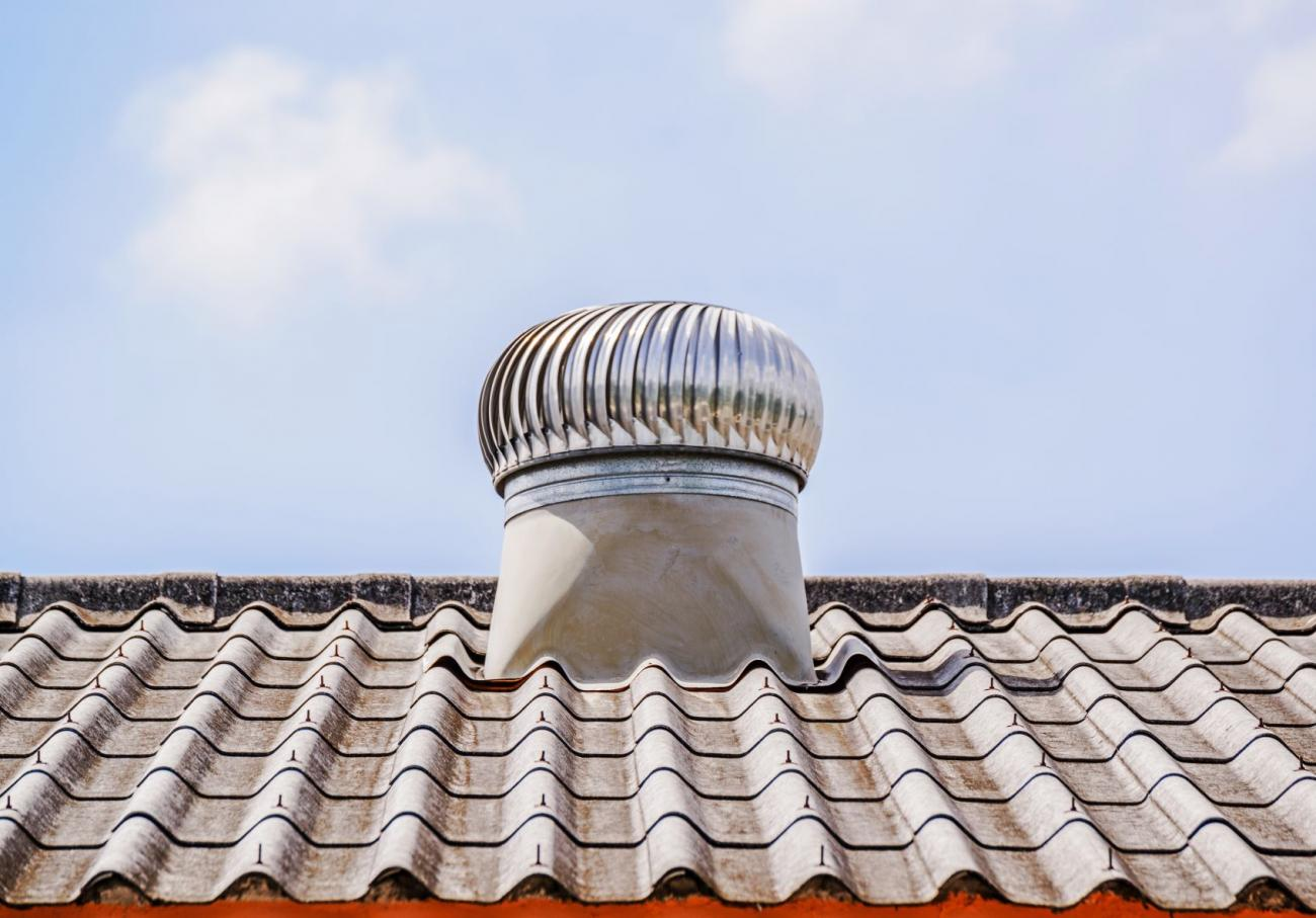 Attic vent system on home roof